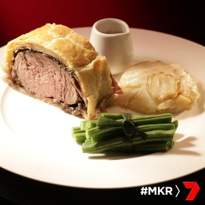 Beef wellington with potato galette and green beans