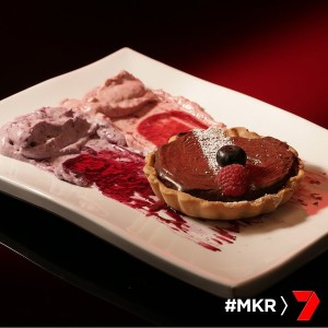 chocolate tart with raspberry and blueberry cream